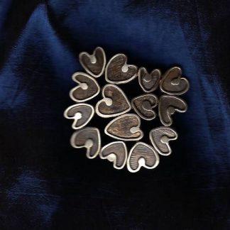 Zilveren harten broche