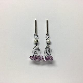 Foto van lange zilveren oorbellen